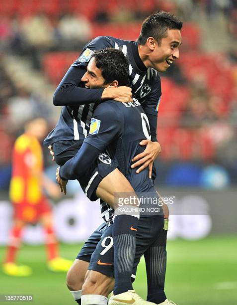 Mexico's Monterrey Jesus Zavala celebrates his goal with teammate Aldo De Nigris during their match for fifth place at the Club World Cup against...