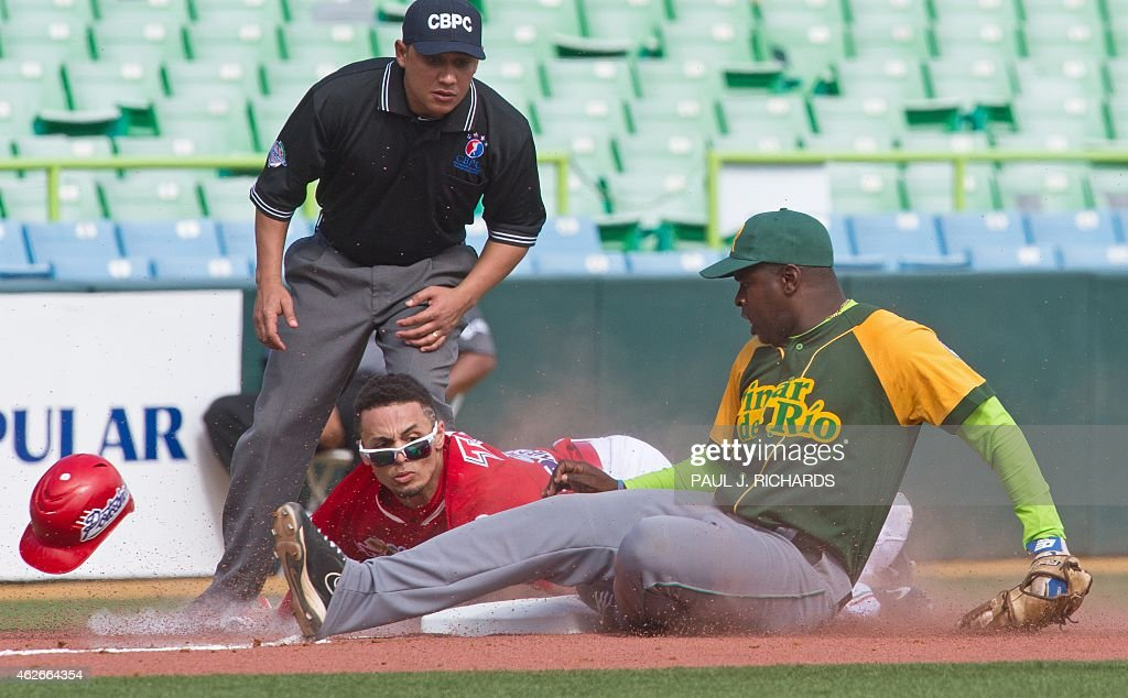 Mexico's National baseball team Rico Noel steals third base as Cuba's third baseman Donald Duarte tries to tag during the 6th inning of San Juan...