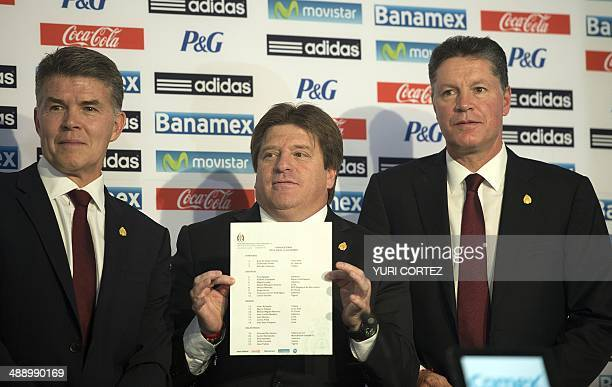 Mexico's national football team coach Miguel Herrera shows the list of footballers who will take part in the next FIFA 2014 Brazil World Cup...