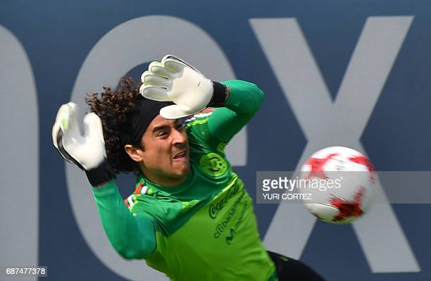 Mexico's national football team goalkeeper Guillermo Ochoa stops the ball during a training session ahead of the World Cup qualifier against Honduras...