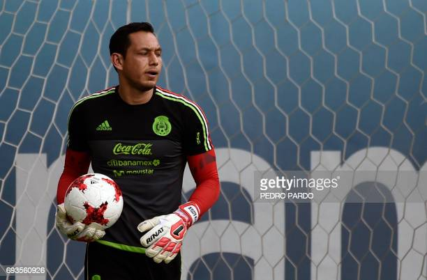 Mexico's national football team goalkeeper Rodolfo Cota takes part in a training session ahead of the World Cup qualifier against Honduras and the...