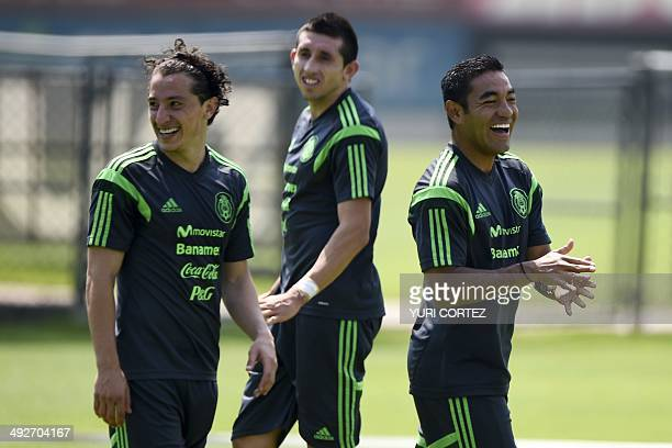 Mexico's national football team midfielder Andres Guardado Hector Herrera and midfielder Marco Fabian smile during a training session at the High...