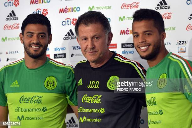 Mexico's national football team players Carlos Vela and Giovani dos Santos and coach Juan Carlos Osorio pose for photos during a press conference...