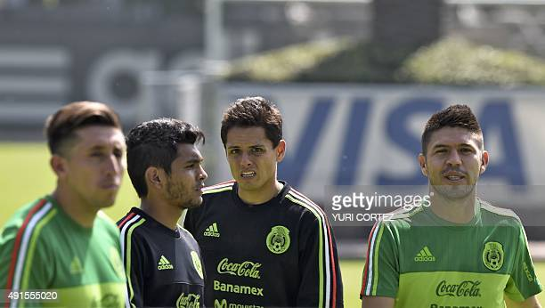 Mexico's national team football players midfielders Hector Herrera Jesus Corona and forwards Javier Hernandez and Oribe Peralta participate in a...