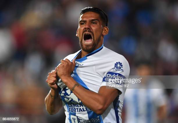 Mexico's Pachuca forward Franco Jara celebrates after scoring a goal against US's FC Dallas Hernan Grana during their CONCACAF Champions League...