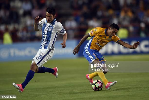 Mexico's Pachuca Hirving Lozano vies for the ball with Mexico´s Tigres Javier Aquino during their CONCACAF Champions League Final football match at...