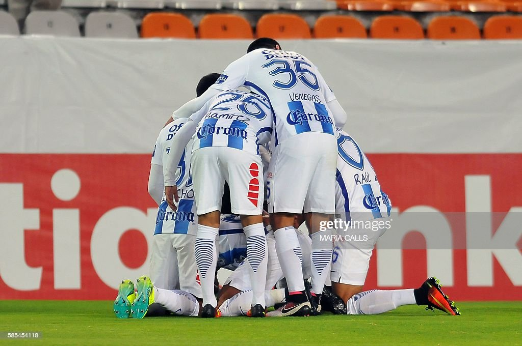 Mexico's Pachuca players celebrate a goal during a CONCACAF Champions League football match against Honduras' Olimpia at the Hidalgo stadium on...