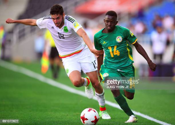 Mexico's Paolo Yrizar fights for the ball with Senegal's Ousseynou Niang during their U20 World Cup round of 16 football match between Mexico and...