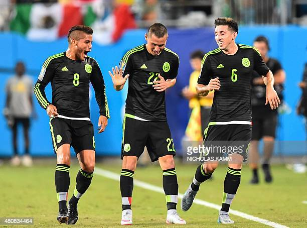 Mexico's Paul Aguilar celebrates scoring against Trinidad and Tobago with Jonathan Dos Santos and Hector Herrera during a CONCACAF Gold Cup Group C...