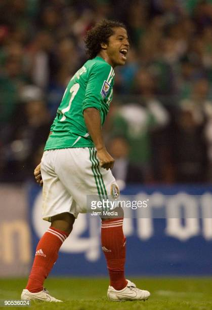 Mexico's player Giovani Dos Santos reacts during their FIFA 2010 World Cup Qualifying match a gaint Honduras at the Azteca Stadium on September 9...