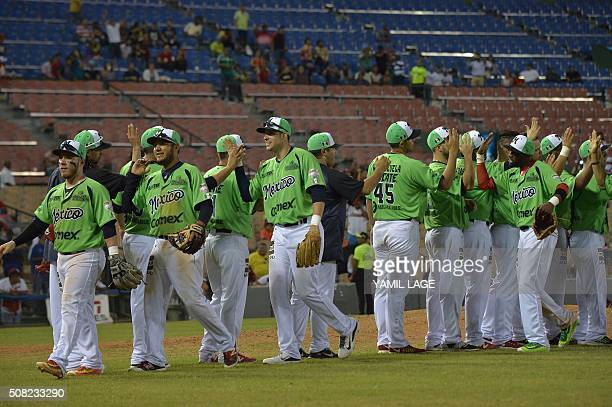 Mexico's players celebrate after defeating Venezuela in their 2016 Caribbean baseball series game on February 3 2016 in Santo Domingo Dominican...