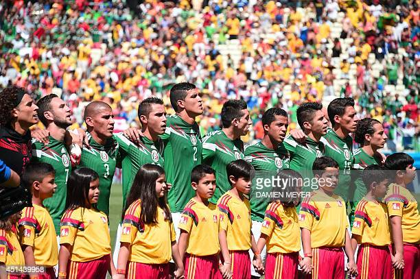 Mexico's players sing their national anthem prior to a Round of 16 football match between Netherlands and Mexico at Castelao Stadium in Fortaleza...