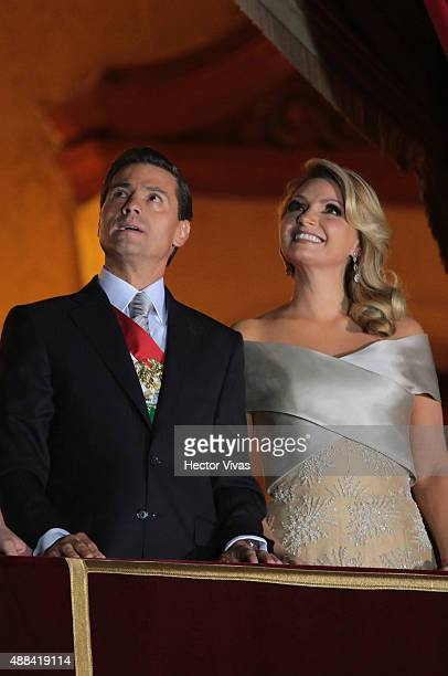 Mexico's President Enrique Pe–ña Nieto and first lady Angelica Rivera watch the fireworks after giving the traditional 'El Grito' during the...