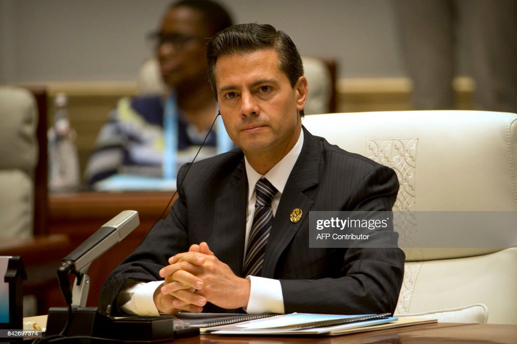Mexico's President Enrique Pena Nieto attends the Dialogue of Emerging Market and Developing Countries on the sidelines of the 2017 BRICS Summit in Xiamen, southeastern China's Fujian Province on September 5, 2017. Xi opened the annual summit of BRICS leaders that already has been upstaged by North Korea's latest nuclear weapons provocation. / AFP PHOTO / POOL / Mark Schiefelbein