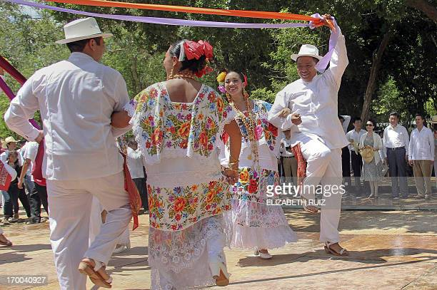 Mexico's President Enrique Pena Nieto China's President Xi Jinping and his wife lady Peng Liyuan look at a Mexican traditional dance during a visit...