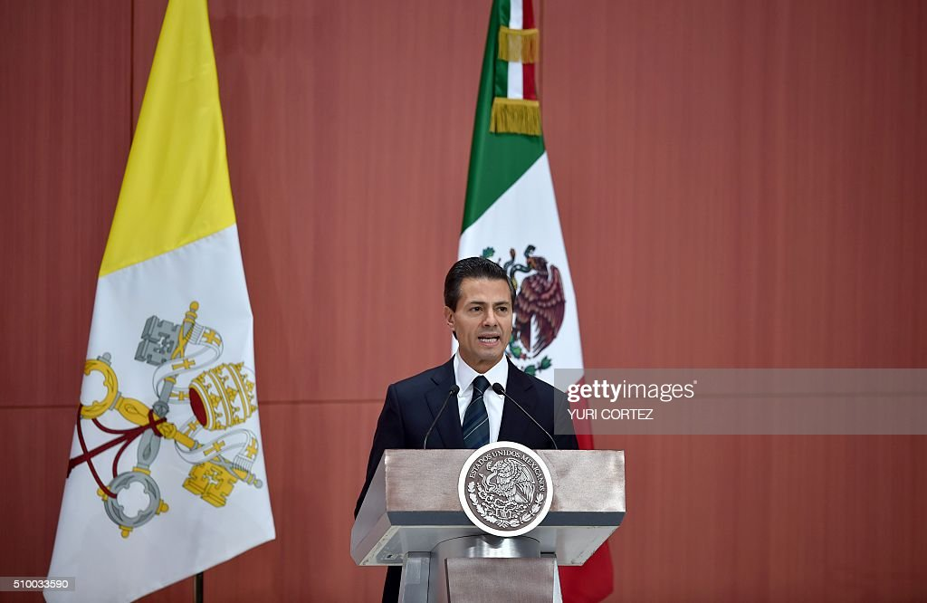 Mexico's President Enrique Pena Nieto delivers a message during the welcoming ceremony of Pope Francis at the National Palace on February 13, 2016 in Mexico City. Pope Francis called on Mexico's leaders Saturday to provide 'true justice' and security to citizens hit by drug violence as he addressed politicians at the National Palace. AFP PHOTO/ Yuri CORTEZ / AFP / YURI CORTEZ