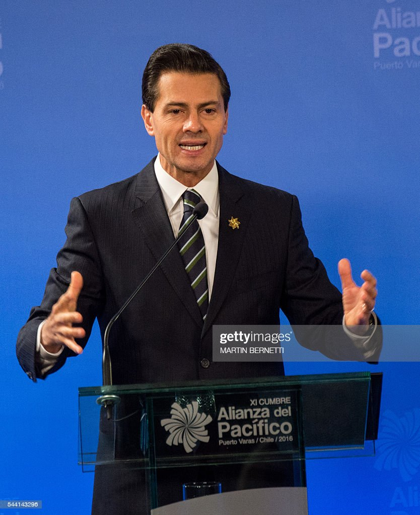 Mexico's President Enrique Pena Nieto delivers a speech during the XI Pacific Alliance Summit in Puerto Varas, 1150 km south of Santiago, Chile, on July 1, 2016. / AFP / Martin BERNETTI