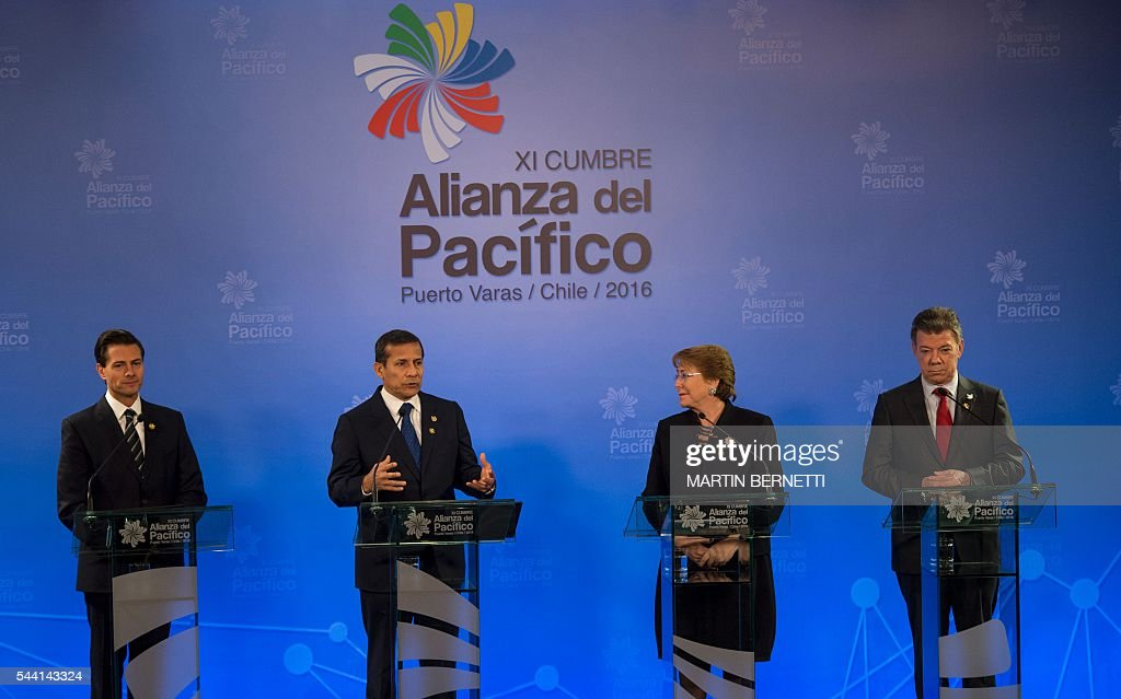 Mexico's President Enrique Pena Nieto, Peru's President Ollanta Humala, Chile's President Michelle Bachelet and Colombia's President Juan Manuel Santos participate in the XI Pacific Alliance Summit in Puerto Varas, 1150 km south of Santiago, Chile, on July 1, 2016. / AFP / Martin BERNETTI