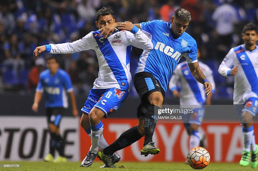 Mexico´s Puebla Alberto Acosta vies for the ball with Argentina´s Racing Gostavo Bou during the Copa Libertadores 2016 football match at Cuauhtemoc...