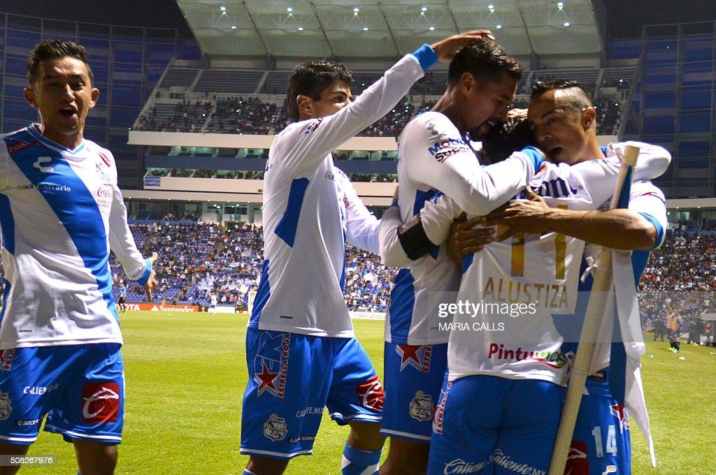 Mexico´s Puebla Matias Alustiza celebrates with teammates his goal against Argentina´s Racing during the Copa Libertadores 2016 football match at...
