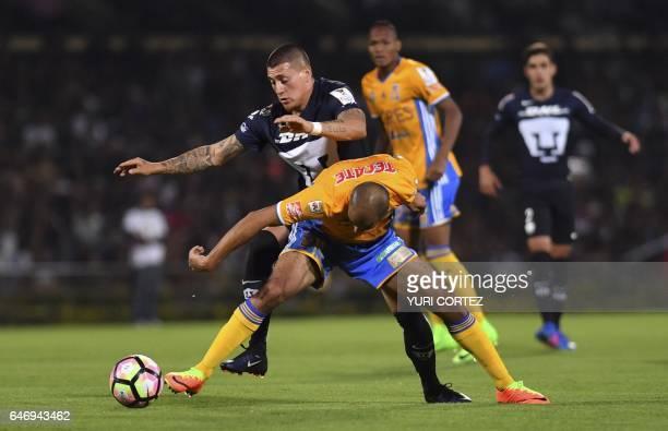 Mexico's Pumas forward Nicolas Castillo vies for the ball with Mexico's Tigres defender Guido Pizarro during their CONCACAF Champions League quarter...