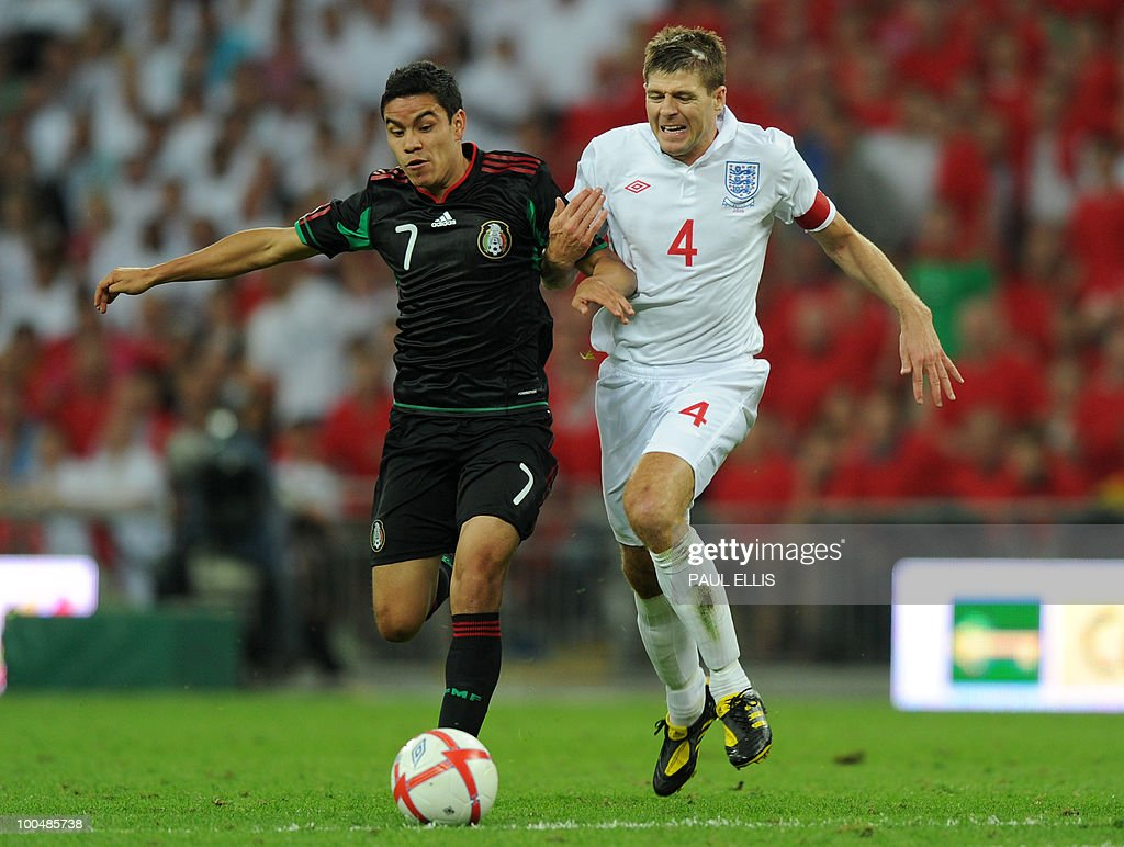 Mexico's Rafael Marquez (L) beatsEngland's Steven Gerrard during their international friendly football match at Wembley Stadium in London on May 24, 2010 AFP PHOTO/Paul Ellis