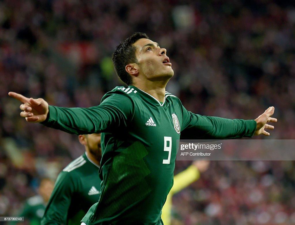 Mexico's Raul Jimenez celebrates scoring during the friendly football match Poland v Mexico at the Ergo Arena in Gdansk, Poland, on November 13, 2017. /