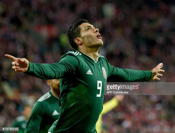 Mexico's Raul Jimenez celebrates scoring during the friendly football match Poland v Mexico at the Ergo Arena in Gdansk Poland on November 13 2017 /...