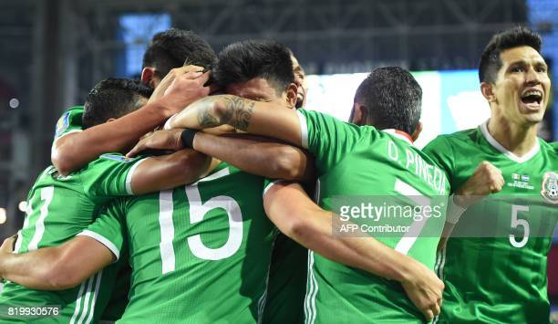Mexico's Rodolfo Pizarro and teammates celebrate his goal against Honduras during their quarterfinal CONCACAF Gold Cup match on July 20 2017 at the...