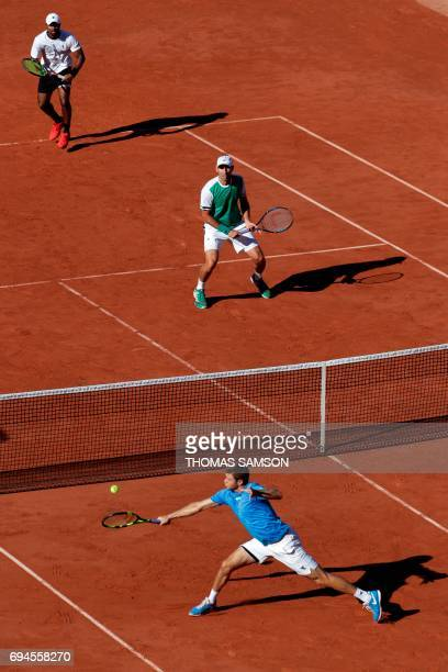 Mexico's Santiago Gonzalez and US Donald Young play play against US Ryan Harrison and NewZealand's Michael Venus during their men doubles final...