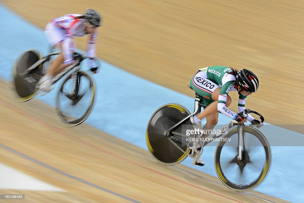 Mexico's Sofia Arreola Navarro (R) competes to win the silver medal in UCI Track Cycling World Championships Women's 25 km Point Race in Belarus' capital of Minsk on February 23, 2013.