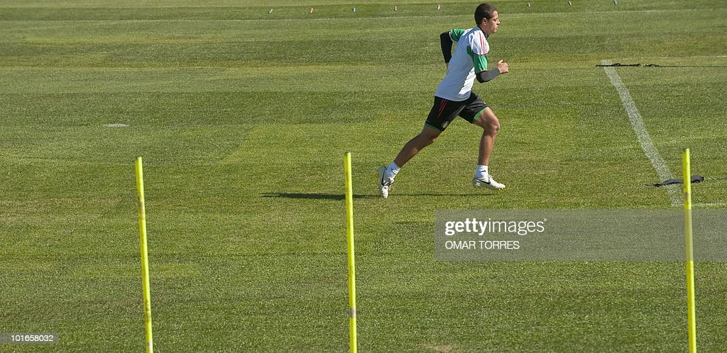 Mexico's striker Javier Hernandez Hernandez warms up during a training session of the Mexico national football team at the Waterstone College in Johannesburg on June 6, 2010. The 2010 World Cup will take place in South Africa from June 11 to July 11, the first time on African soil for the biggest and most prestigious competition in sport.