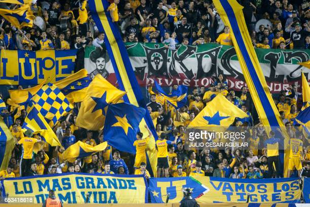 Mexico's Tigres supporters cheer for their team during their CONCACAF Champions League football match against Canada's Vancouver Whitecaps at the...