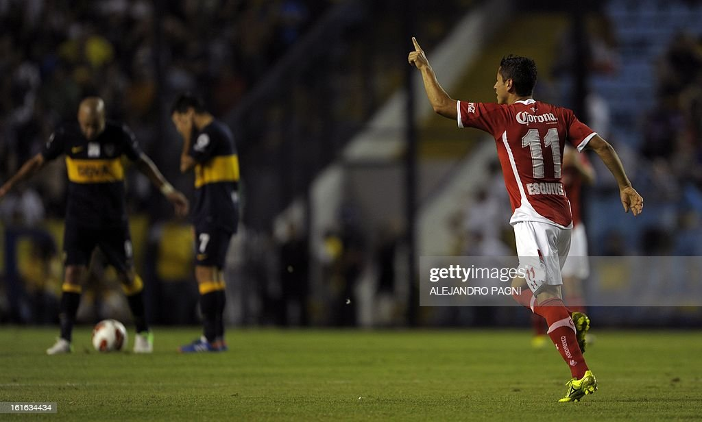 Mexico's Toluca forward Carlos Esquivel (R) celebrates after scoring a goal against Argentina's Boca Juniors during their Copa Libertadores 2013 Group 1 football match at 'La Bombonera' stadium in Buenos Aires, Argentina, on February 13, 2013.