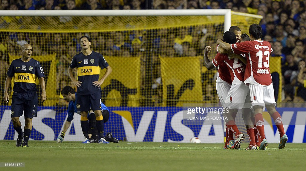 Mexico's Toluca forward Carlos Esquivel celebrates with teammates after scoring a goal against Argentina's Boca Juniors during their Copa Libertadores 2013 Group 1 football match at 'La Bombonera' stadium in Buenos Aires, Argentina, on February 13, 2013. AFP PHOTO / Juan Mabromata