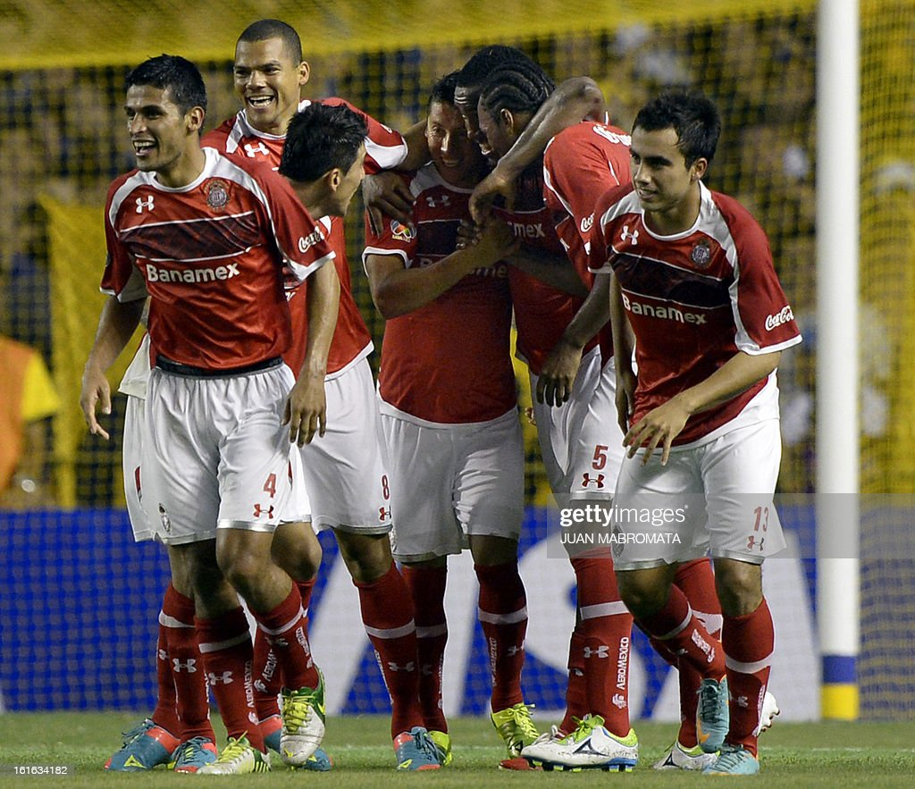 Mexico's Toluca forward Carlos Esquivel (C) celebrates with teammates after scoring against Argentina's Boca Juniors during their Copa Libertadores 2013 Group 1 football match at 'La Bombonera' stadium in Buenos Aires, Argentina, on February 13, 2013. AFP PHOTO / Juan Mabromata