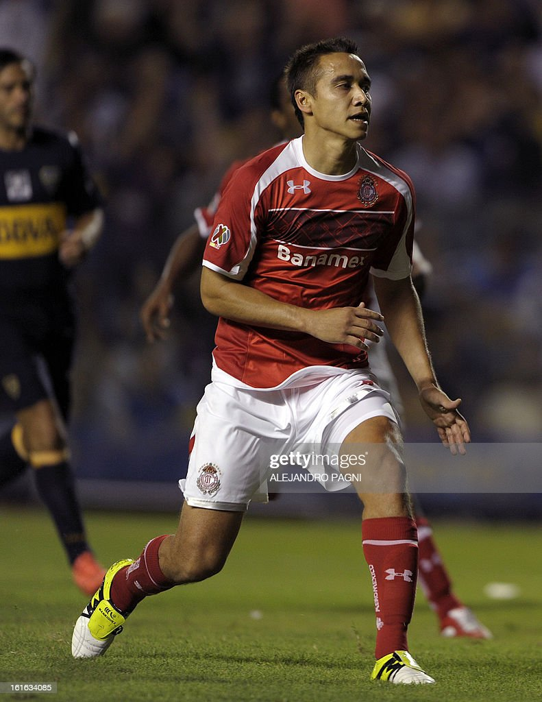 Mexico's Toluca forward Edgar Benitez (C) reacts after failing a penalty kick against Argentina's Boca Juniors during their Copa Libertadores 2013 Group 1 football match at 'La Bombonera' stadium in Buenos Aires, Argentina, on February 13, 2013.