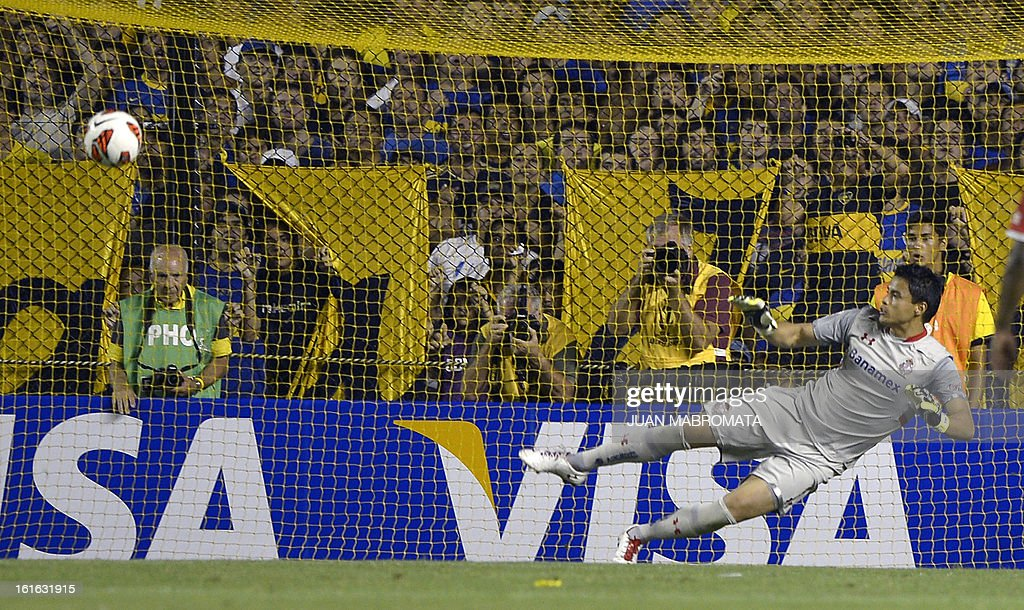 Mexico's Toluca goalkeeper Alfredo Talavera fails to stop a penalty shot by Argentina's Boca Juniors forward Santiago Silva (not in frame), during the Copa Libertadores 2013 Group 1 football match against Mexico's Toluca, at 'La Bombonera' stadium in Buenos Aires, Argentina, on February 13, 2013. AFP PHOTO / Juan Mabromata