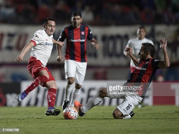 Mexico's Toluca midfielder Antonio Rios vies for the ball with Argentina's San Lorenzo midfielder Fernando Belluschi during the Copa Libertadores...