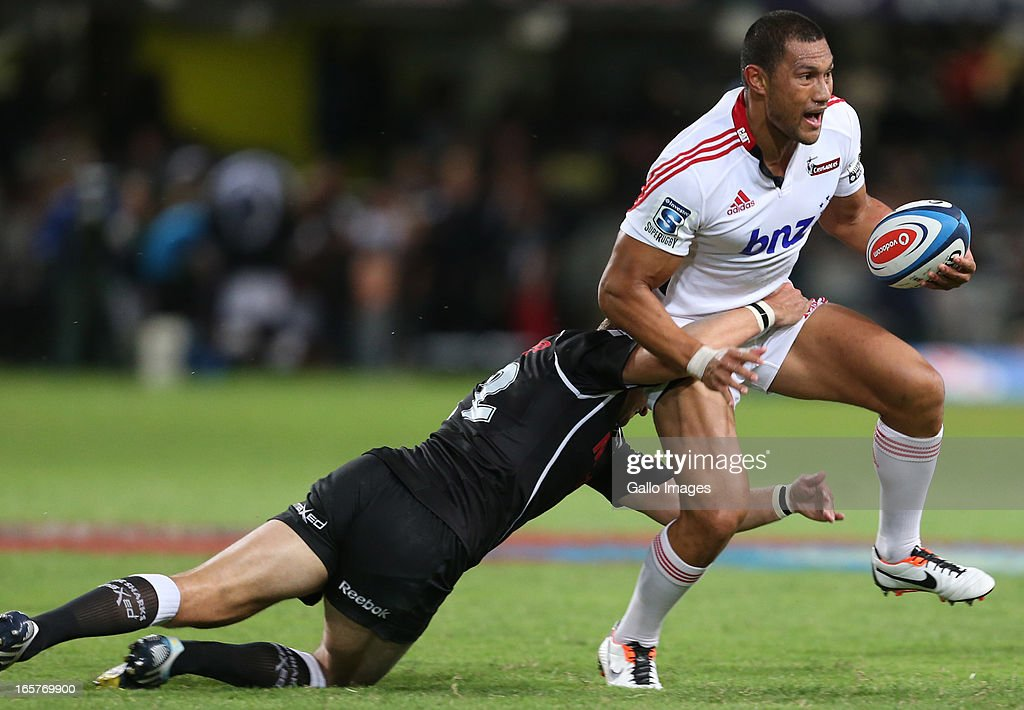 Meyer Bosman of Sharks tackles Robbie Fruean of Crusaders during the Super Rugby match between The Sharks and Crusaders from Kings Park on April 05, 2013 in Durban, South Africa.