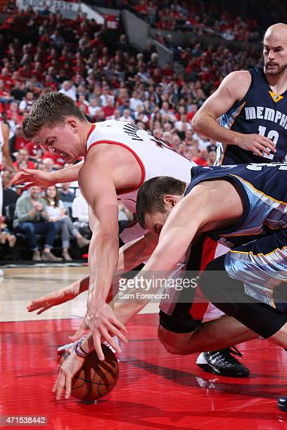 Meyers Leonard of the Portland Trail Blazers and Marc Gasol of the Memphis Grizzlies dive for a loose ball in Game Four of the Western Conference...