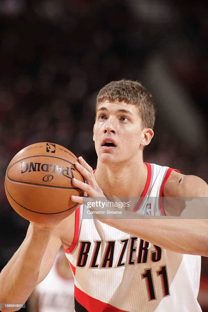 <a gi-track='captionPersonalityLinkClicked' href=/galleries/search?phrase=Meyers+Leonard&family=editorial&specificpeople=6893999 ng-click='$event.stopPropagation()'>Meyers Leonard</a> #11 of the Portland Trail Blazers attempts a foul shot against the Sacramento Kings on December 26, 2012 at the Rose Garden Arena in Portland, Oregon.