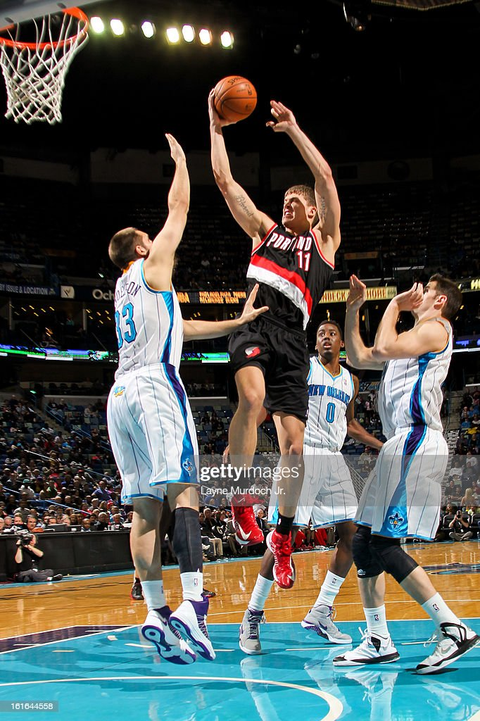 Meyers Leonard #11 of the Portland Trail Blazers drives to the basket against Ryan Anderson #33 of the New Orleans Hornets on February 13, 2013 at the New Orleans Arena in New Orleans, Louisiana.