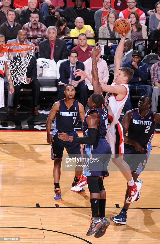 <a gi-track='captionPersonalityLinkClicked' href=/galleries/search?phrase=Meyers+Leonard&family=editorial&specificpeople=6893999 ng-click='$event.stopPropagation()'>Meyers Leonard</a> #11 of the Portland Trail Blazers dunks against <a gi-track='captionPersonalityLinkClicked' href=/galleries/search?phrase=Jeff+Adrien&family=editorial&specificpeople=727235 ng-click='$event.stopPropagation()'>Jeff Adrien</a> #4 of the Charlotte Bobcats on March 4, 2013 at the Rose Garden Arena in Portland, Oregon.