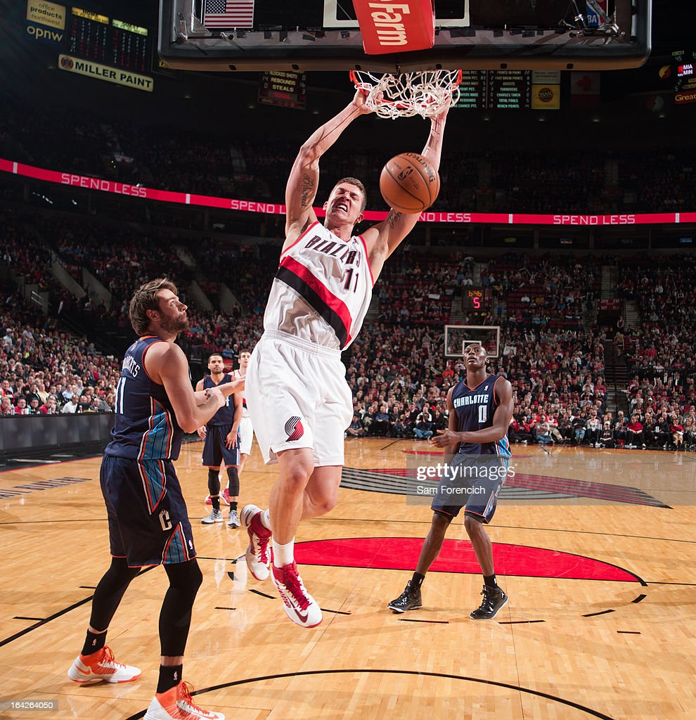 <a gi-track='captionPersonalityLinkClicked' href=/galleries/search?phrase=Meyers+Leonard&family=editorial&specificpeople=6893999 ng-click='$event.stopPropagation()'>Meyers Leonard</a> #11 of the Portland Trail Blazers dunks against <a gi-track='captionPersonalityLinkClicked' href=/galleries/search?phrase=Josh+McRoberts&family=editorial&specificpeople=732530 ng-click='$event.stopPropagation()'>Josh McRoberts</a> #11 of the Charlotte Bobcats on March 4, 2013 at the Rose Garden Arena in Portland, Oregon.