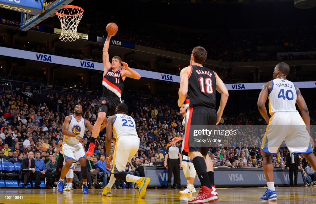 Meyers Leonard #11 of the Portland Trail Blazers dunks against the Golden State Warriors on March 30, 2013 at Oracle Arena in Oakland, California.