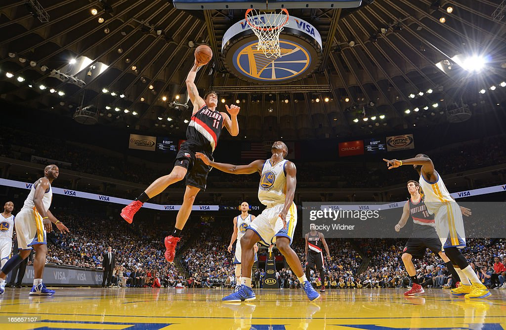 <a gi-track='captionPersonalityLinkClicked' href=/galleries/search?phrase=Meyers+Leonard&family=editorial&specificpeople=6893999 ng-click='$event.stopPropagation()'>Meyers Leonard</a> #11 of the Portland Trail Blazers goes up for the dunk against <a gi-track='captionPersonalityLinkClicked' href=/galleries/search?phrase=Harrison+Barnes&family=editorial&specificpeople=6893973 ng-click='$event.stopPropagation()'>Harrison Barnes</a> #40 of the Golden State Warriors on March 30, 2013 at Oracle Arena in Oakland, California.