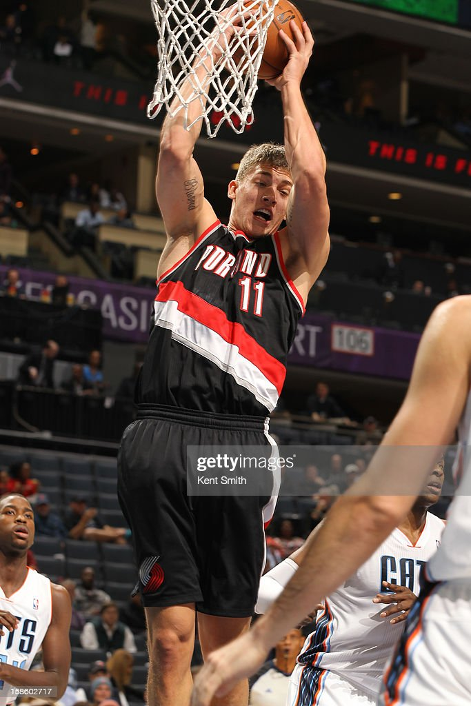 Meyers Leonard #11 of the Portland Trail Blazers grabs a rebound against the Charlotte Bobcats at the Time Warner Cable Arena on December 3, 2012 in Charlotte, North Carolina.