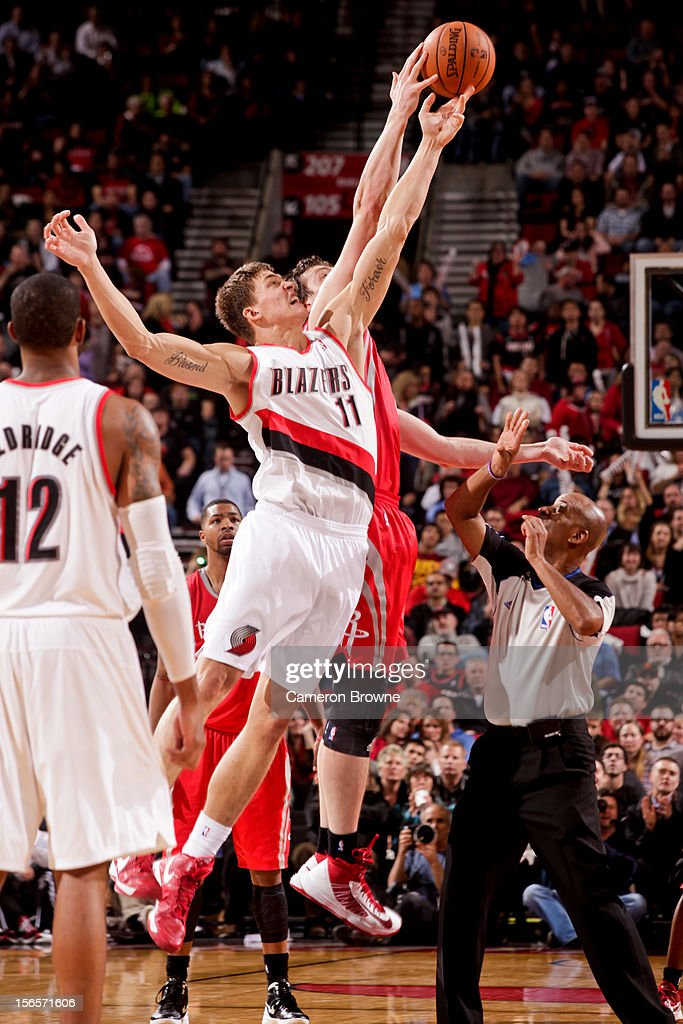<a gi-track='captionPersonalityLinkClicked' href=/galleries/search?phrase=Meyers+Leonard&family=editorial&specificpeople=6893999 ng-click='$event.stopPropagation()'>Meyers Leonard</a> #11 of the Portland Trail Blazers jumps for the overtime tip-off against the Houston Rockets on November 16, 2012 at the Rose Garden Arena in Portland, Oregon.