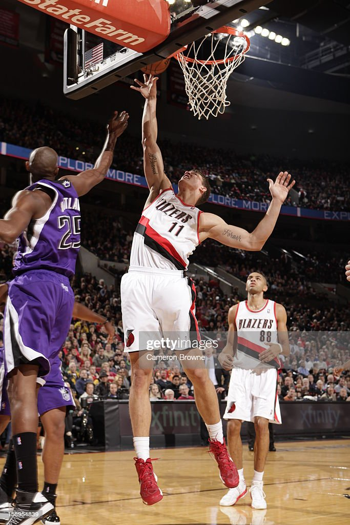 <a gi-track='captionPersonalityLinkClicked' href=/galleries/search?phrase=Meyers+Leonard&family=editorial&specificpeople=6893999 ng-click='$event.stopPropagation()'>Meyers Leonard</a> #11 of the Portland Trail Blazers puts up a shot against the Sacramento Kings on December 26, 2012 at the Rose Garden Arena in Portland, Oregon.
